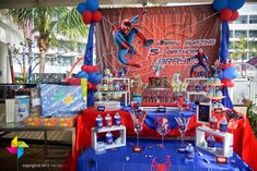 Backdrop and cake / candy table for a Spider-Man themed birthday party! Design and setup by ParteeBoo - The Party Designers.
