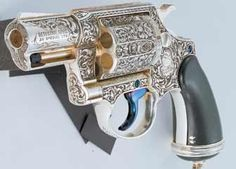 """The """"Vampire Exterminator"""" Colt Detective Special was engraved by Colt master engraver Leonard Francolini and cased in a specially fabricated ebony casket. Rifles, Gun Art, Custom Guns, Fire Powers, Cool Guns, Big Guns, Guns And Ammo, Self Defense, Tactical Gear"""