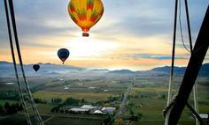 Early risers can see the wineries of Napa Valley from a new angle—floating high above in a hot-air balloon. Photo from Calistoga Balloons; trips with the company leave around dawn. California wine country #california #wine