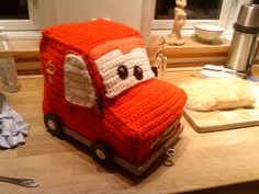 "I have crocheted Postman Pats car, with a little inspiration from the movie ""Cars"" :)"