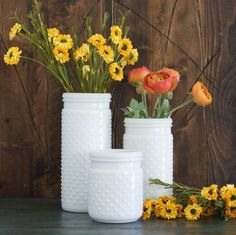 """These glass jars work well as vases, a pretty display of kitchen utensils or to organize office supplies. Pair with our Ranunculus Stems or Yellow Flower Bush for a perfect pop of color! - Small: 4"""" X"""