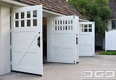 Hand Made Custom Wood Garage Doors And REAL Carriage House. Paint your garage wall grey, to create the contemporary look more powerful. Swing Out Garage Doors, Genie Garage Door, Custom Garage Doors, Carriage Garage Doors, Wood Garage Doors, Garage Entry, Barn Garage, Custom Garages, Garage Walls