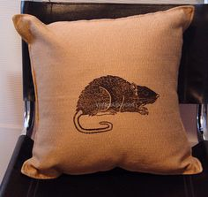 A personal favorite from my Etsy shop https://www.etsy.com/listing/74074779/rat-pillow-goth-geekery-genius-artists