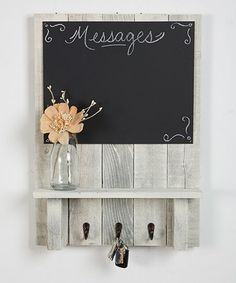 Add a touch of shabby-chic flair to your walls with this handy memo board boasting a large chalkboard for notes and messages, hooks for hanging keys and other items and a shelf for storage or decorative display.