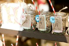 mason jar cups with colorful paper straws with place card tags tied to it.