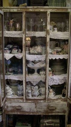 .V ery old..hand made cabinet for storage or I think pie safe....anyway I love it...so worn and well used