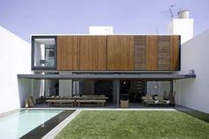 Shipping container vision...love the wall compound feel!!! Casa RO / Elías Rizo Arquitectos
