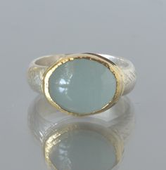 Aquamarine Ring in 18K Gold and Silver Ring-Aquamarine Cocktail Ring-March Birthstone Statement Ring by ZeniaLisJewelry on Etsy https://www.etsy.com/listing/263654741/aquamarine-ring-in-18k-gold-and-silver