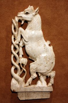 Openwork plaque with a rampant goat eating a plant, openwork plaque with a rampant goat eating a plant. Neo-Assyrian, ca. 8th century B.C., Mesopotamia, Nimrud (ancient Kalhu). Courtesy  currently located at the Metropolitan Museum of Art, New York. Photo taken by Peter Roan.