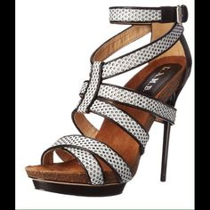 HP Top Trends 6/17  L.A.M.B. Beatrice Sandal Bring the heat in the Beatrice. This L.A.M.B. sandal is made with grey and black textured straps that hang from every angle. An adjusting buckle, 5 1/2 inch heel and cork 1 inch platform finish this sleek stiletto.  Brand new never worn.   Shoe Details:  Leather Upper Leather Sole This Shoe Fits True To Size. L.A.M.B. Shoes Sandals
