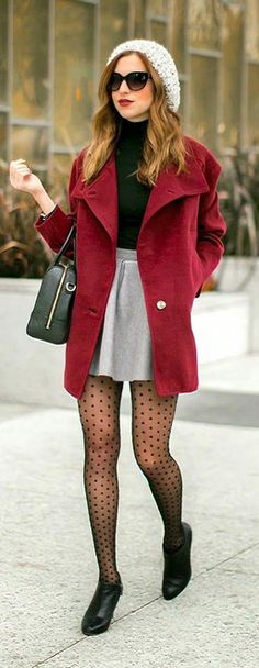 A dark red coat and a grey skater skirt