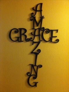 Amazing grace cross I made with hobby lobby wood letters and E6000