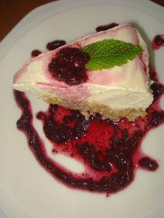 raw vegan lemon cheesecake with blueberry sauce