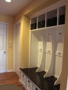 Hall closet turned mudroom Elizabeth great idea for you since you have that big closet by laundry/garage :)