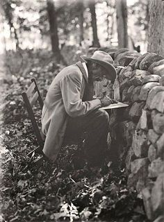 The picture was taken at the Stone Wall at Gettysburg in 1913. Picture shows the old soldier writing his memories of the Battle of Gettysburg, at the Gettysburg Reunion.