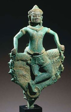 KRISHNA KALIYA Khmer, Bayon period 12th-13th c. Bronze with green patina H: 10 ½ inches with tang (26.7 cm)