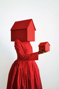 Not the color or polka dots - the lack of face and repetition of object.  Guda Koster - Thread, Fashion and Costume
