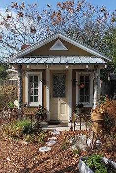 Garden shed?  Craft studio?  Woman cave?  L.O.V.E.....I would LOVE this in my yard!!! and get so much use out of it!!