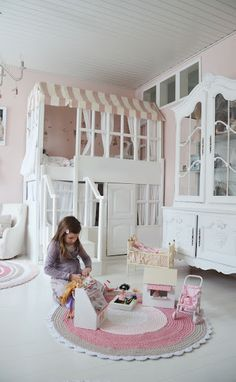 bunkbed turned playhouse, roof awning makes a canopy over bed, this is lovely for a little girl