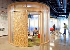 AOL headquaters: Plywood barn door & small translucent meeting pod...