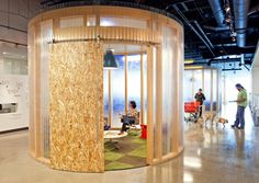 AOL headquaters: Plywood barn door & small translucent meeting pod by O+A