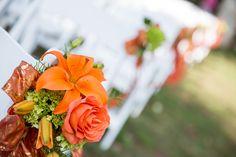 Aisle decorations for a lovely fall wedding. Designed by Jen-Mor Florist in Dover, Delaware. www.jenmor.com #fallweddings #weddingflowers