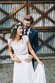 Rustic boho bride wearing two piece wedding dress and groom in navy suit | Raconteur Photography