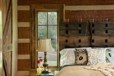 Master suite with hewn log walls & trim