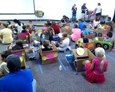 "130 kids & parents made ""cars"" for the Library Drive-In Movie last Tuesday -"