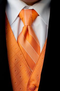 An orange vest and striped tie for the groom. Orange is Jamess favorite color! wedding colors september / fall color wedding ideas / color schemes wedding summer / wedding in september / wedding fall colors Orange Vests, Orange Tie, Orange Color, Pale Orange, Yellow, Sharp Dressed Man, Well Dressed Men, Dusty Blue, Traje A Rigor