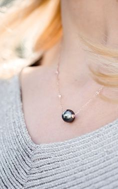 With its beautiful and rich color, this Tahitian pearl necklace will make the ultimate statement. Single Pearl Necklace, Tahitian Pearl Necklace, Pearl And Diamond Necklace, Tahitian Pearls, Gems Jewelry, Pearl Jewelry, Modern Jewelry, Beautiful Necklaces, Pendant Necklace