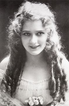 The first movie-inspired fashion fad was Hollywood star Mary Pickford's curls. The big secret was her hair wasn';t all her hair; it was were augmented by hair of Los Angeles prostitutes, employees of Bit Suzy's French Whorehouse. Thus Mary Pickford and her beauty team started a long tradition of impossible-to-achieve beauty standards.