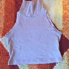 AA cropped turtleneck tank in Heathered Oatmeal Cute but too small on me! Size small American Apparel. Make an offer! American Apparel Tops