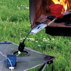 FlameStower Mobile Device Charger / Charging your phones during camping trips has become a natural process with the FlameStower Mobile Device Charger. http://thegadgetflow.com/portfolio/flamestower-mobile-device-charger/