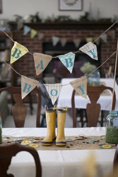 Love the rain boots used as #babyshower decor!
