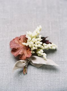 Elegant Spring wedding boutonniere by Sarah Winward.