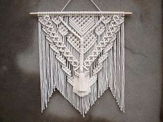 Macrame wall hanging Color: off-white. Material: unbleached cotton rope, wood. Length of the wood is approx 85 cm (33.5 inches); macrame canvas is approx max 88 cm (34.5 inches) long. More macrame wall hangings https://www.etsy.com/shop/PapuShoi?section_id=19482238 If you have any