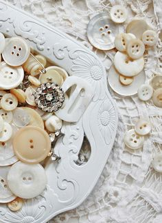 A gathering of vintage MOP and creamy white buttons.