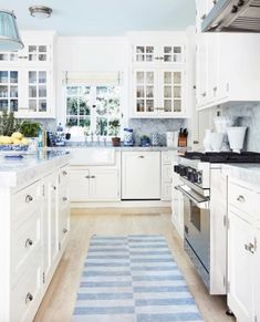 """Shades of blue and white make for a cheerful, crisp kitchen. """"I love blue-and-white dhurries,"""" Mark says. """"My new collection for Merida is inspired by many of these antique Indian textiles."""" Inside the personal home of Mark Sikes kitchen Crisp Kitchen, Kitchen Redo, New Kitchen, Kitchen Cabinets, Kitchen Ideas, White Cabinets, Kitchen Makeovers, Kitchen White, Upper Cabinets"""