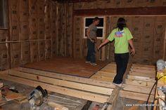 raise a sunken bedroom floor | The floor joists are going in.