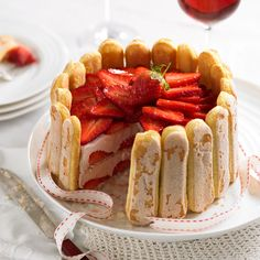 This elegant summer time dessert is made up of sponge and strawberry mousse layers