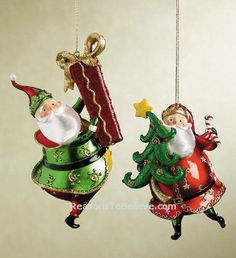2 Santa ornaments - packed full of color and shine, each holding the perfect Christmas gift. One with a large gold bow, the other a beautiful Christmas tree and star. Beautiful Christmas Trees, Perfect Christmas Gifts, Santa Ornaments, Christmas Decorations, Holiday Decor, Hand Carved, Carving, Bows, Star