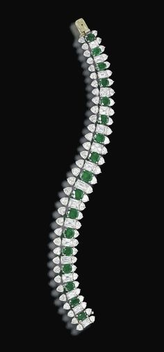 AN EMERALD AND DIAMOND BRACELET, BY HARRY WINSTON  Designed as a series of oval-shaped emeralds alternately spaced by rectangular-cut diamonds, to the triangular-shaped diamond border, mounted in platinum, 17.7 cm long With maker's mark of Jacques Timey for Harry Winston