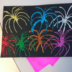 Firework craft using black construction paper, Elmer's glue and glitter.