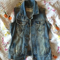 Denim Vest On trend, perfect amount of distressing. It used to be a denim jacket, but I repurposed it to make it a vest. 4 pockets. Excellent condition. No trades/No PayPal. Aeropostale Jackets & Coats Vests