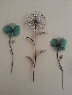 HUGE metal wall art decor from Bed Bath and Beyond. I have this set up, alternating the smaller (still about 2 ft tall) sparkley aqua flowers with the larger sunburst sparkle dandelions, on either side of my fireplace mantle.
