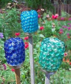Jars turned garden art - try w/more interestingly shaped object such as a vase....