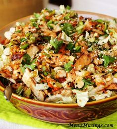 Grilled Ginger-Sesame Chicken Salad - - I found this recipe from celebrity chef Curtis Stone in one of my magazines, pulled it out, and knew I had to make it. I am SO happy that I did! The salad was easy to make, FULL of HUGE flavors, and very little fat. The dressing that doubles as the marinade for the grilled chicken, gives us salty soy, sweet hoisin, spicy sriracha, and rich sesame oil all dancing together in this amazing dressing. In short - Yes! It's amazing!