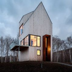 Plates of weathering steel frame the doorway to this timber-clad home, designed by Design Base 8 and Omar Gandhi for a remote site on Canada's Cape Breton Residential Architecture, Interior Architecture, Clad Home, Gable Roof, Tiny House Cabin, Unusual Homes, Photo Instagram, Bari, Architect Design