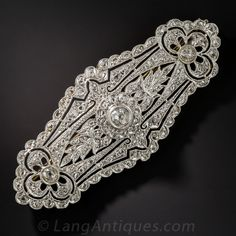 Edwardian Diamond Brooch. This very early Edwardian jewel, rendered in platinum over 18k yellow gold, is impeccably hand fabricated with superb attention paid to every detail. Reminiscent of the finest Venetian lace tapestries, this brooch is completely encrusted with diamonds which twinkle from every angle like tiny stars.